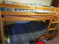 A very good condition, wooden bunk bed that is cosy and comfortable for children