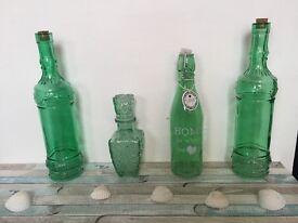4 green glass bottles