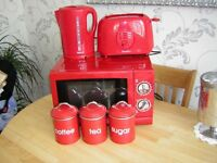 Microwave,kettle,toaster, and matching canisters