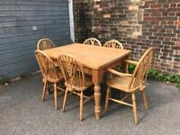 Lovely pine farmhouse table with six vintage wheel back chairs.,