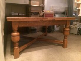 Antique Arts and Crafts Jacobean style carved oak refectory table with draw leaf