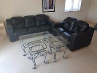 2 x Black leather sofas in good condition (including tables)