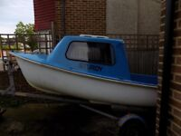Handy fishing dinghy with cuddy.