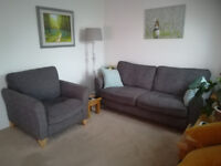 Grey Sofa and matching Armchair.