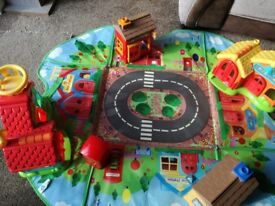 Huge Happy Land bundle with play mats and carry case, inc. Police/fire station, school and shops