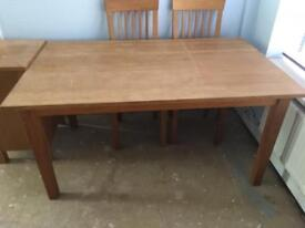 Extending solid dining table