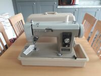 New home electric sewing machine and case for sale