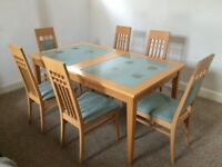 Extendable dining table with 6 chairs from John. E. Coyle