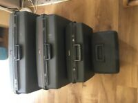 Set of 4 Delsey hard suitcases