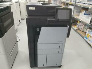REPOSSESSED HP LaserJet Enterprise flow M830z M830 MFP Black and White Printer Copier Scanner with a spped of 56 PPM.