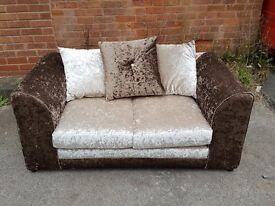 Cute brown and mink crushed velvet 2 seater sofa. 1 month old. Clean and tidy. Can deliver