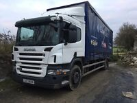 Curtain side Scania lorry.