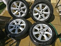 """Four 16"""" 5 Stud Genuine Mazda 3 (2012) alloy wheels and tyres."""
