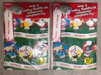 Personalised Christmas wrapping paper and bow x2
