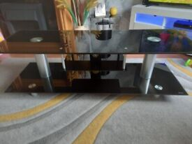 Large heavy weight black glass tv stand