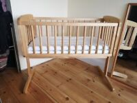 Wooden swinging baby crib