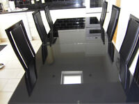 Black Glass extending table and six chairs
