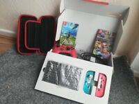 Nintendo Switch (Like New) with Mario Kart 8, Zelda BOTW, Case + More