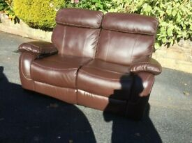 Two seater, manual reclining, faux leather sofa