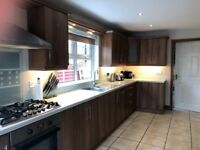 Fitted walnut kitchen with units and appliances