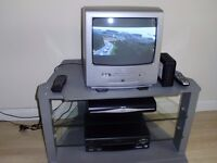 PORTABLE TV WITH BUILT IN DVDPLAYER/VIDEO RECORDER/SKY BOX/REMOTES AND STAND.