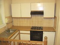 Kitchen units, worktop and sink, all in very serviceable order.