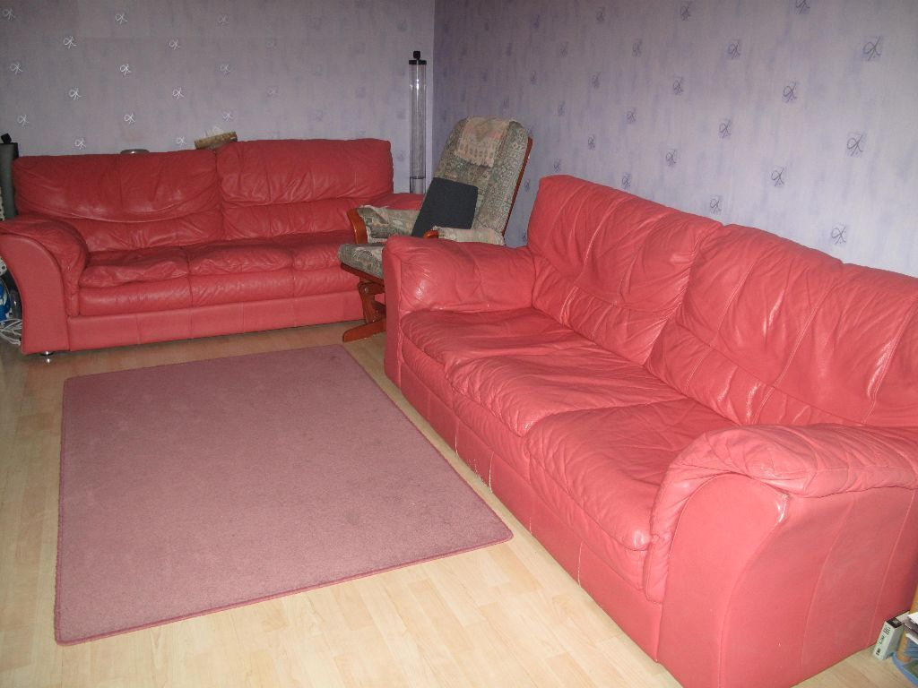 Two 3 seaters DFS Coral Pink leather Sofa