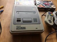 Nintendo SNES with Super Bomberman and Micromachines, two controllers
