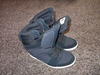 Black high top wedge DC shoes