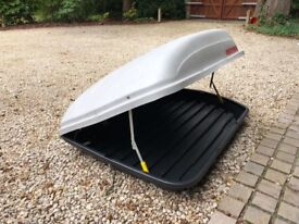 Large capacity car top box with four attachments. Grey in colour hardly used sold as seen