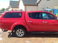 Mitsubishi warrior L200 in red new mot end of march this year reliable runner