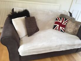 Two brown fabric sofas
