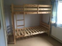 Solid wood bunk beds with third trestle bed. 3 mattresses provided.