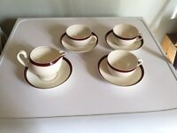 Cups and saucers with milk jug