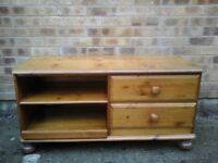 Pine TV unit with 2 x drawrs on right side and shelf on left.