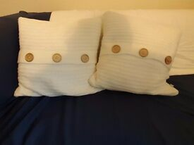 Two Catherine Lansfield knitted cushions in cream