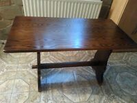 Dark oak stained dining table