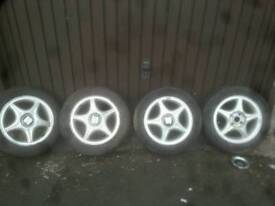 Seat alloy wheels 4 stud 3 good tyers