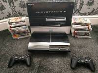 PlayStation 3 PS3, 2 controllers and 25 games