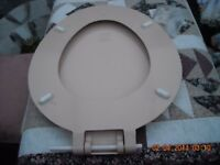 A pale peach toilet seat