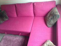 Beautiful pink corner sofa that folds out into a double bed. Large storage section. Barely used.