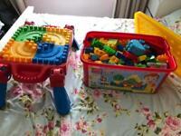 Mega blocks table and box of blocks