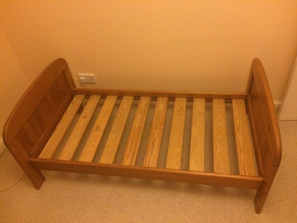 Pine wood toddler bed with mattress, pillow, duvet and bedsheets