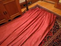 Fully lined red curtains to suit tenement window