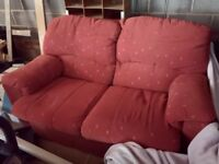 Red 2-seater sofa - free to collector