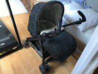 Black polka dot pram and car seat
