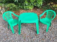 Kids green plastic table and two chairs