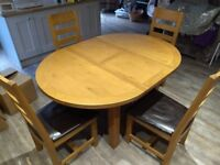 Oak dining table and four chairs.