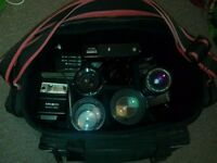 Minolta camera - lenses, flash, filters, instructions and bag