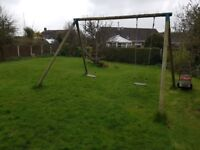 Wooden double swing set, good condition dismantled ready to collect